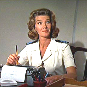 Lois Maxwell as Miss Moneypenny. Note the perfect uniform shirt.