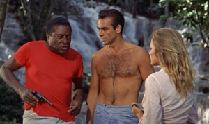 a gentleman keeps his shirt off when others keep their on. John Kitzmiller, Sean Connery, Ursula Andress (who wasn't allowed to voice her own lines!)