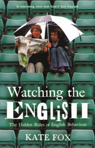the semiotics of Wimbledon spectators: they're not leaving their seats even if its raining, or if there's a two-hour break, because they might lose their seats, they've got a good big umbrella to kep the train off, and they've got the paper. What more do they need?