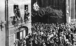 Cambridge students protest against women being admitted to the university by exhibiting an effigy of a woman in bloomers riding a bike.