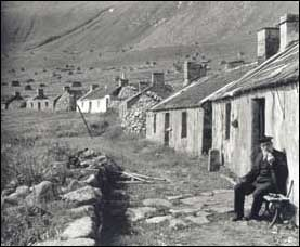 Atkinson's photo of Finlay McQueen outside his house on St Kilda (School of Scottish Studies, University of Edinburgh)